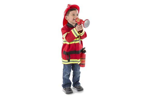 A child wearing the Melissa & Doug Fire Chief Role-Play Costume Set.