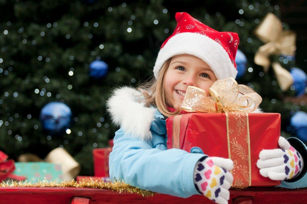 Little girl holding a Christmas present