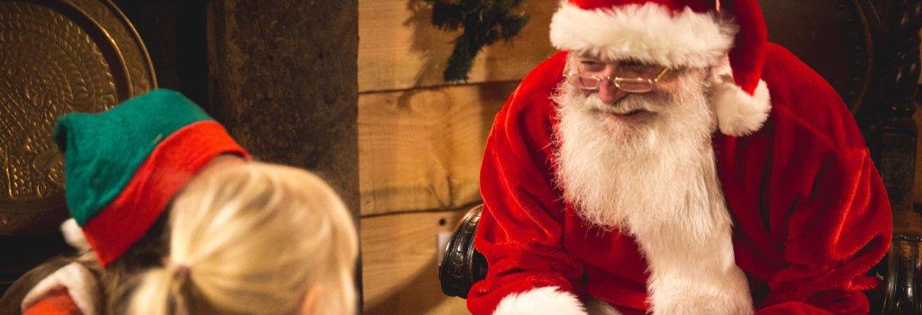 Santa meeting kids at Fishers Farm