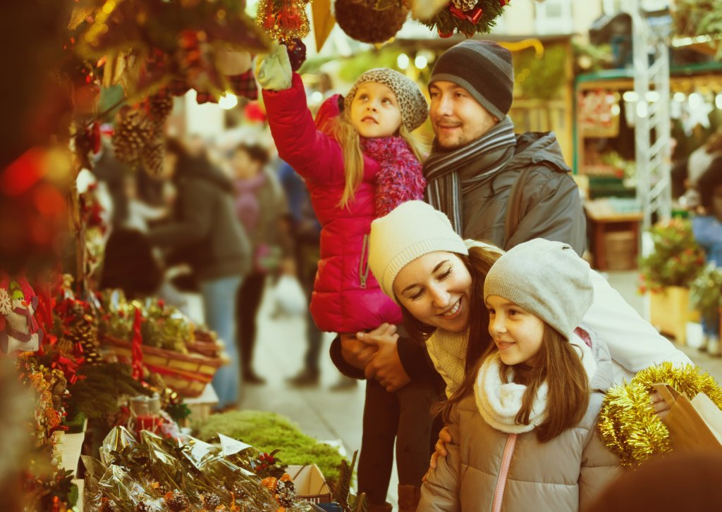 Family on a day out at a Christmas market